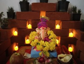ganpati decorations with candles